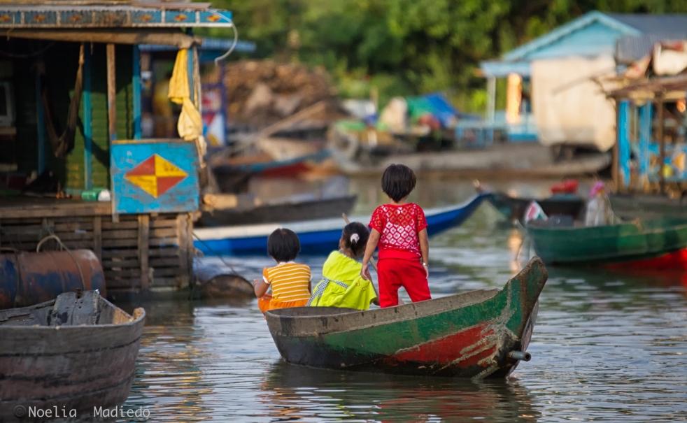 Children going around the floating village